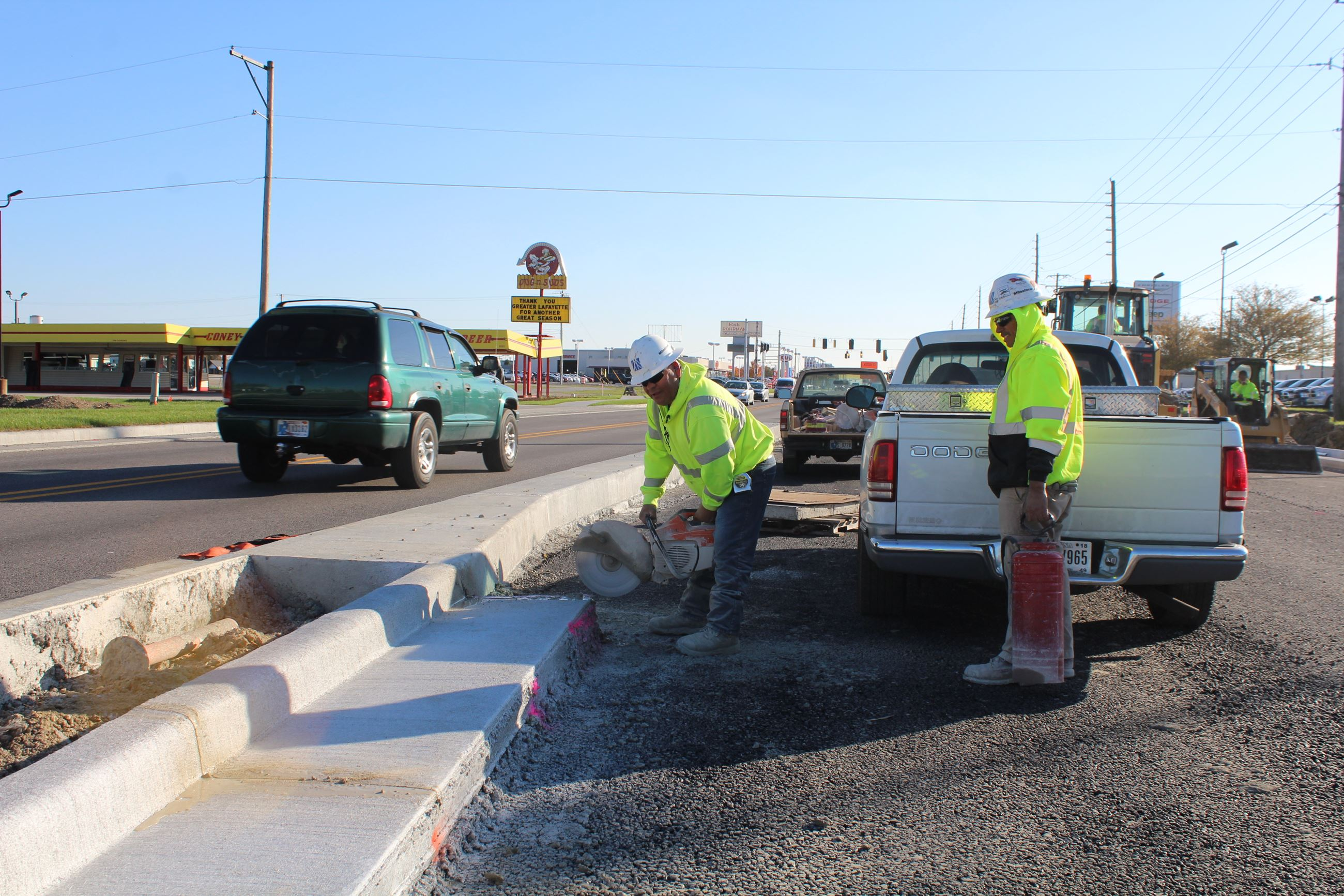 Making controlled cuts in curbs along Sagamore Parkway