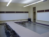 Writing boards, tables and chairs in the North Activity Room of McAllister Center