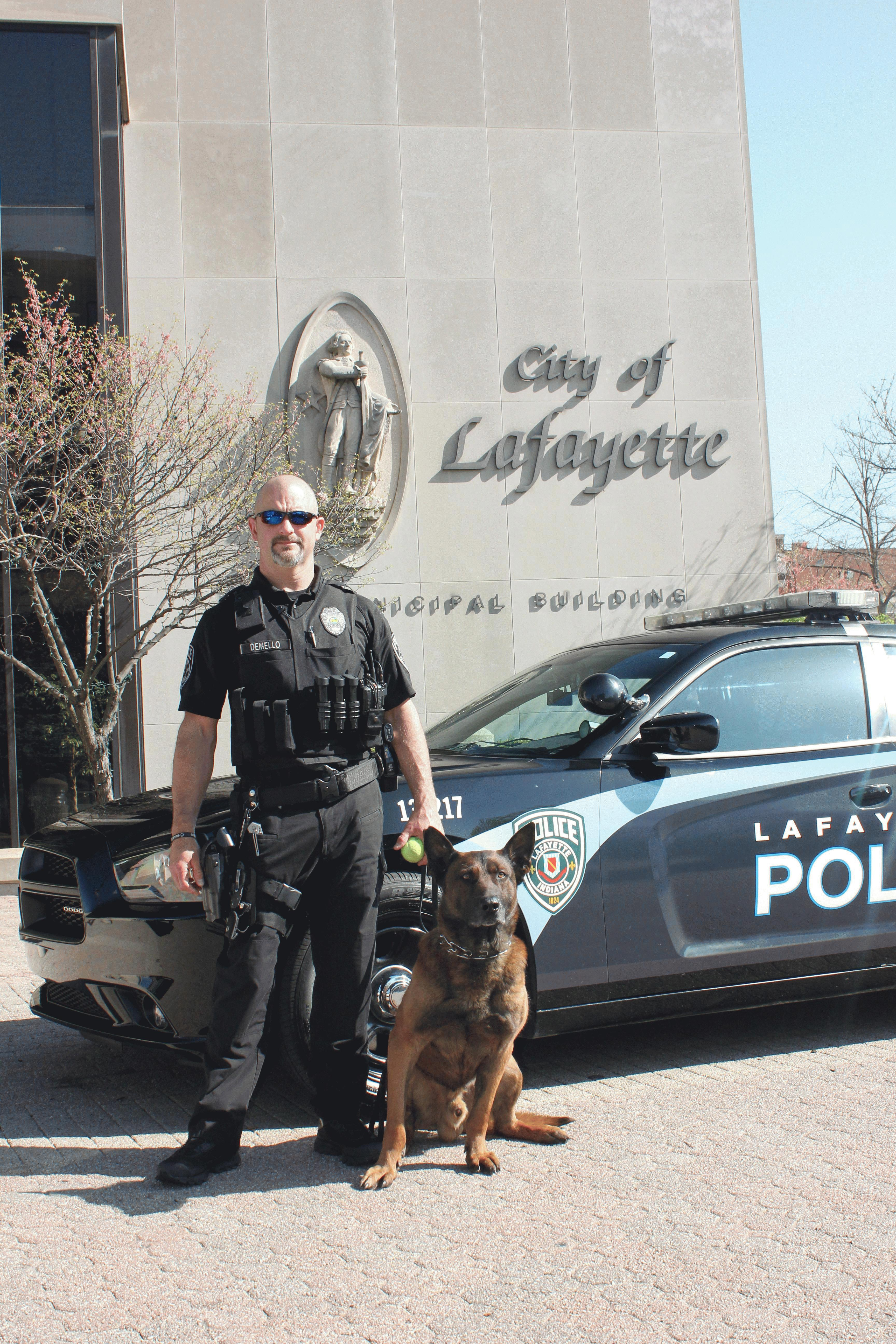 LPD K9 Tico and Officer Albert Demello Next to Pat