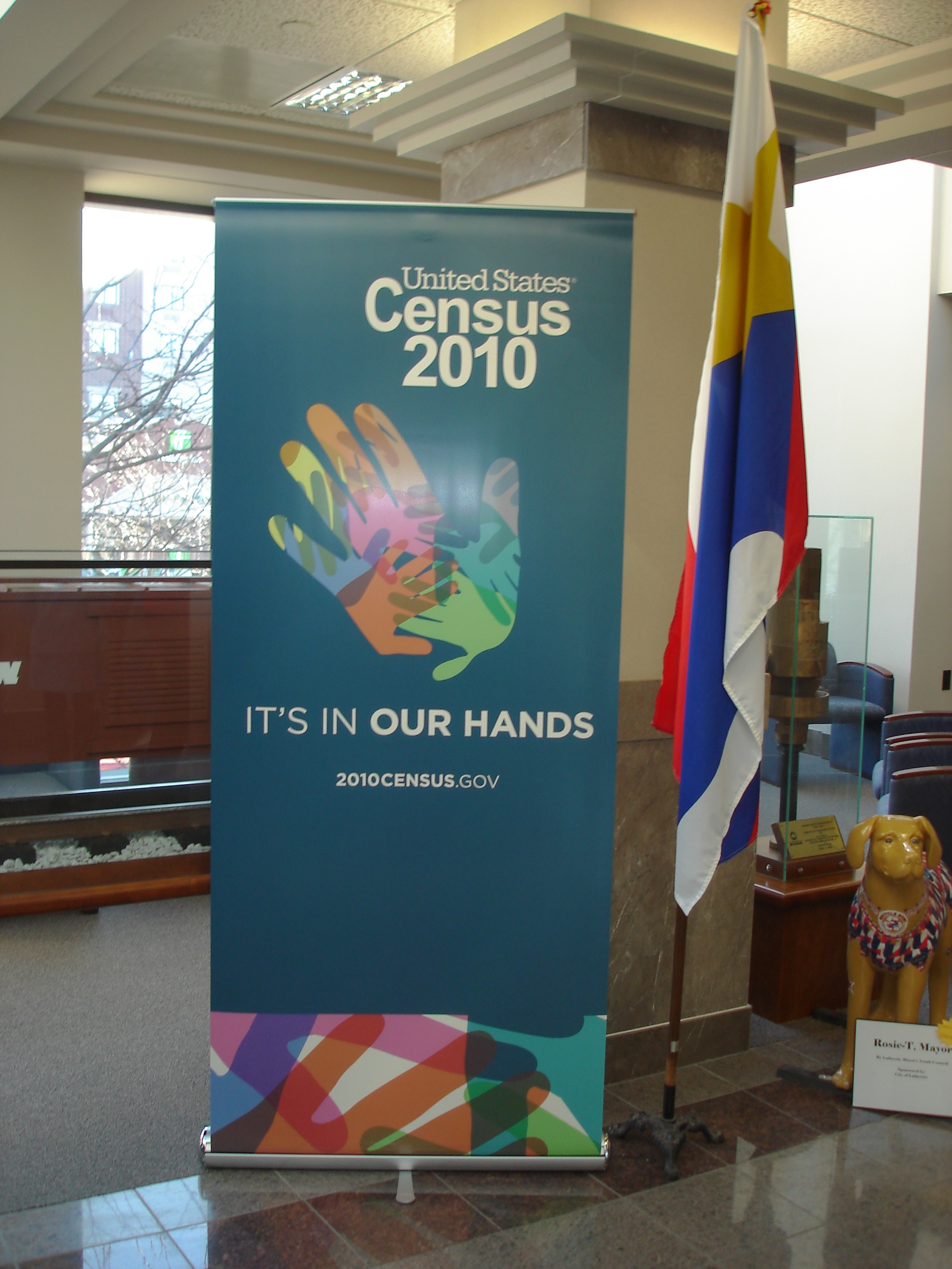 A banner for the 2010 Census next to the state flag