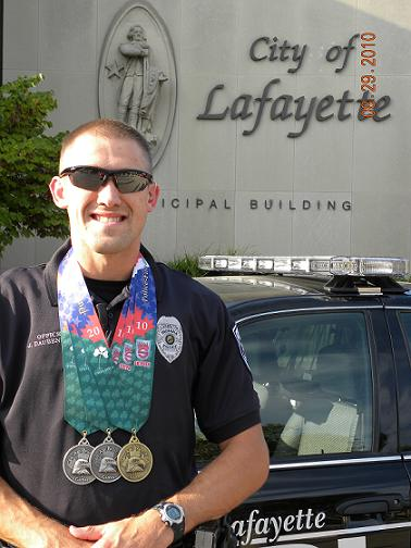 Officer Daubenmier Proudly Displays His Medals in