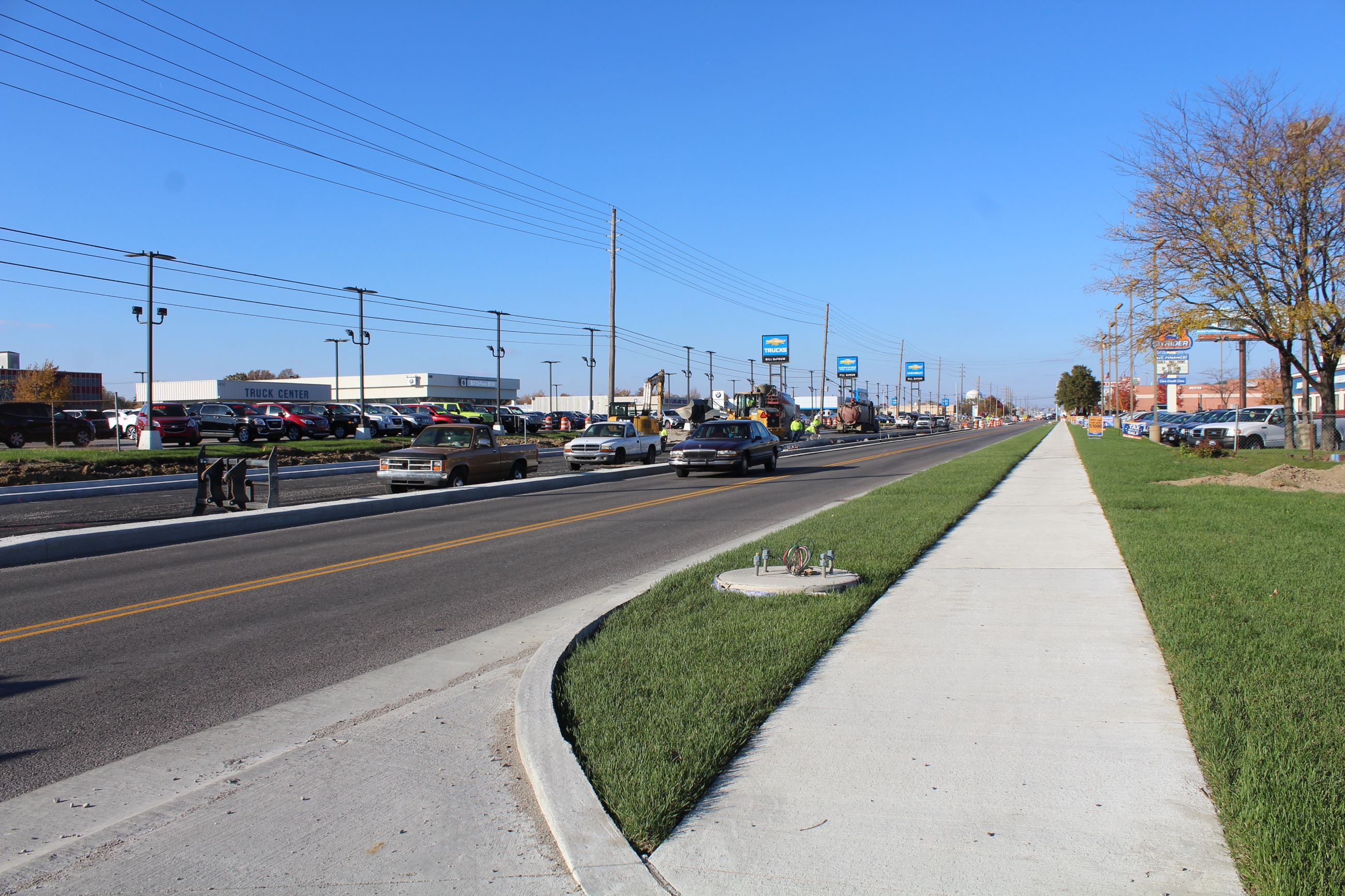 New lanes, sidewalk, curbs, ramps, and landscaping on Sagamore Parkway